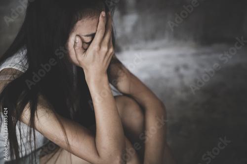 Obraz na plátně Depressed woman sitting on ground, Fear, loneliness, depression, abuse, female i