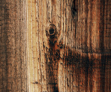 Brown And Yellow Wooden Background From One Sawn Vertical Plank With Traces Of Knots