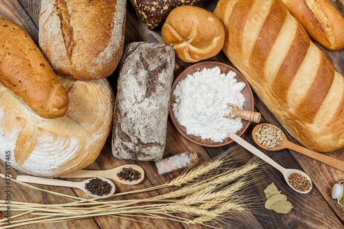 Fotografie, Obraz Lots of loaves of fresh bread and different ingredients