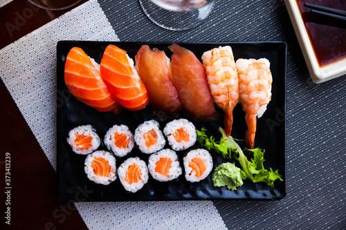 Fototapeta Combined sushi - maki salmon, nigiri variado closeup. Japanese cuisine obraz