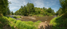 Panorama River With Weir Between Forests, Blue Sky With Gathered