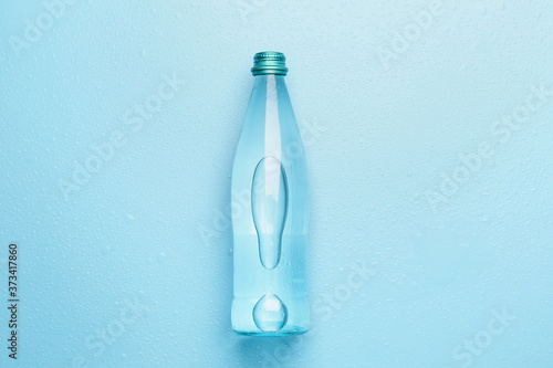 Fototapeta Bottle of clean water on color background
