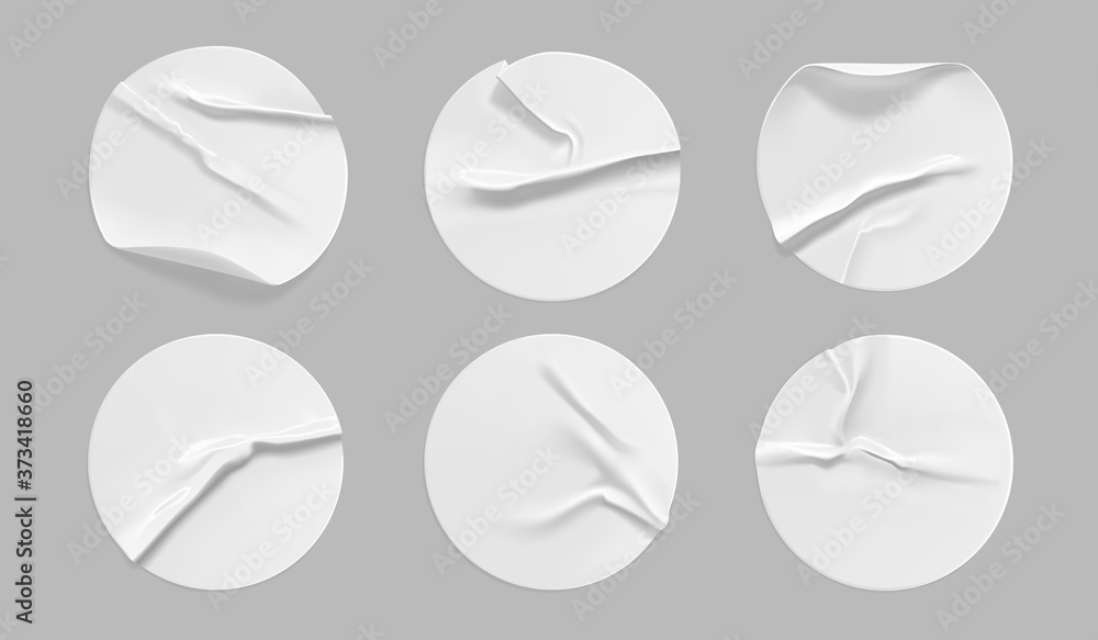 Fototapeta White round crumpled sticker mock up set. Adhesive white paper or plastic sticker label with glued, wrinkled effect on gray background. Blank templates of a label or price tags. 3d realistic vector