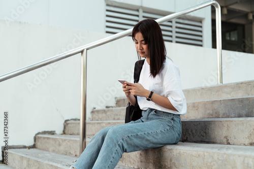 Valokuva Girl on stair.