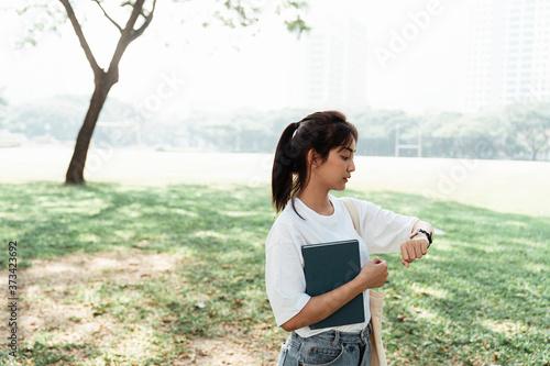 Valokuvatapetti A girl in the university's yard.