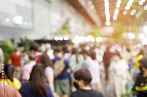 Fotografie, Obraz abstract blur background of people Wearing a mask while walking in festival fair shop selling plants vegetable and tree to decorate house and garden