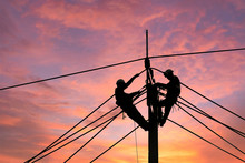 Electrician Worker Climbing El...