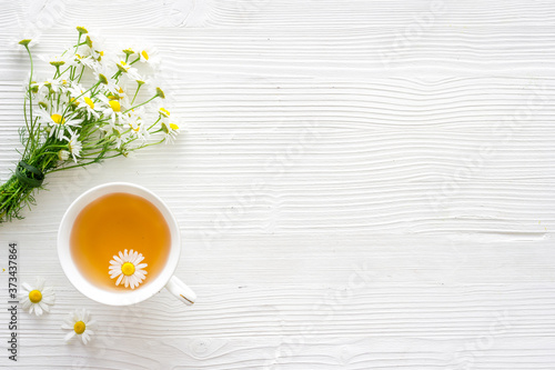 Leinwand Poster chamomile herbal tea in cup top view