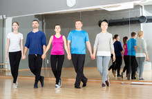 Group Of Adult People Practicing Celtic Dances In Dance Class