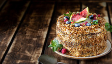 Carrot Cake Decorated With Berries And Figs On A Wooden Background. Traditional Donkey Pastries. Copy Space.