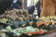 Asian Java Traditonal Meal Of Rice And Side Dishes In Small Banana Leaves. Accompanied By Additional, Optional Side Dishes.