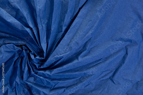 The crumpled paper background top view. Blue colors. Fototapet
