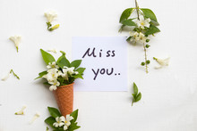 I Miss You Message Card Handwriting With Flowers Jasmine In Cone Arrangement Postcard Style On Background White