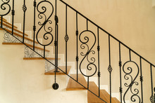 Stair Step With Black Handrail