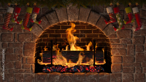 Fototapeta Yule Log in fireplace decorated with christmas stockings