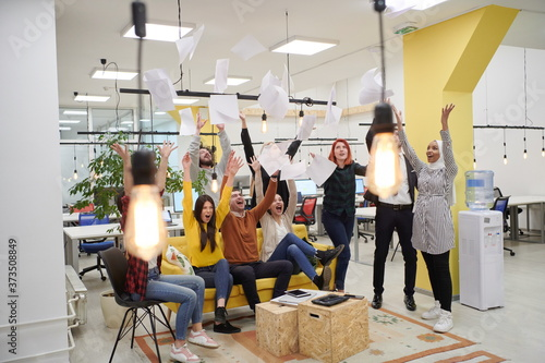 Photo business people throwing paper in air