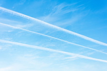 Three Jet Trails In The Blue S...