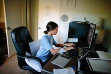 Tween Girl Sits At A Desktop C...