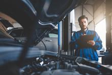 Auto Mechanic Fills In Car Rep...
