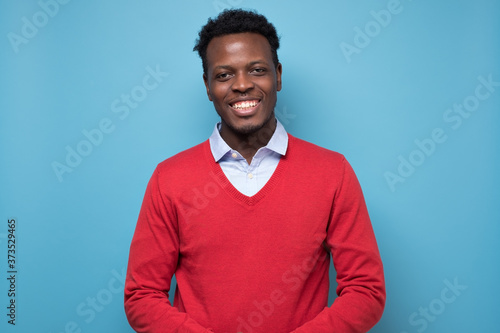 Obraz Portrait of a african smiling young man. - fototapety do salonu