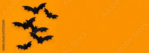 Fotografía Halloween and decoration concept - black paper bats flying over orange backgroun