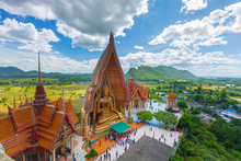 A View From The Top Of The Pagoda, Golden Buddha Statue With Rice Fields And Mountain, Tiger Cave Temple (Wat Tham Seua) Thai And Chinese Temples In Kanchanaburi Province