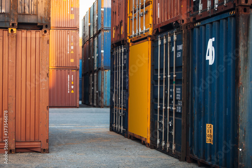 Fotografie, Tablou Stacked cargo containers in storage area of freight sea port terminal