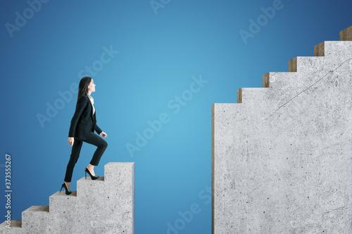 Fototapeta Businesswoman in suit walking on intermittent staircase