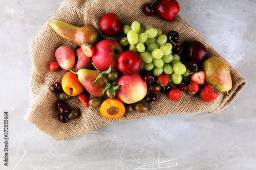 Fresh summer fruits with apple, grapes, berries, plums and healthy apricot.