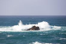 Waves Breaking On Large Rock I...