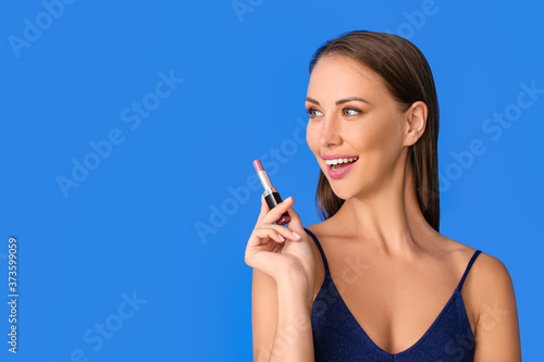 Obraz Beautiful young woman with lipstick on color background - fototapety do salonu