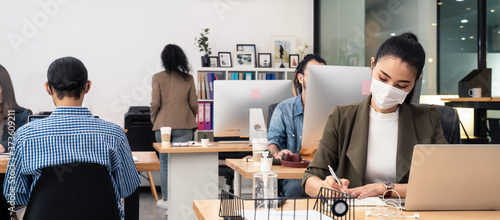 Fototapeta Asian business people working in office with new normal lifestyle. obraz