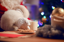 Santa Claus Eating Cookies And Drinking Milk, Closeup