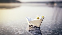 Paper Boat On The Sea