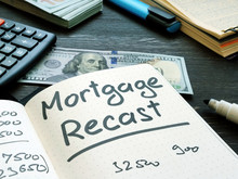 Mortgage Recast Reminder On The Notepad Page.