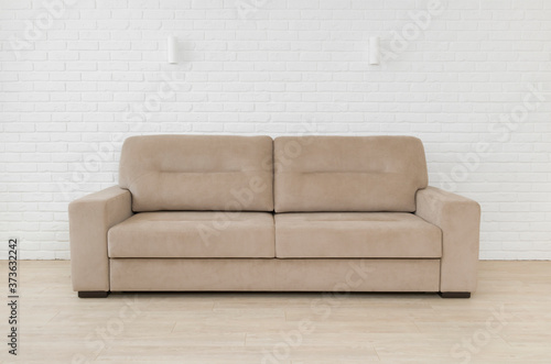 Photo Sofa in living room interior on white brick wall background