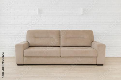 Sofa in living room interior on white brick wall background Fototapeta