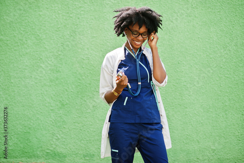 Slika na platnu Portrait of African American female doctor with stethoscope wearing lab coat