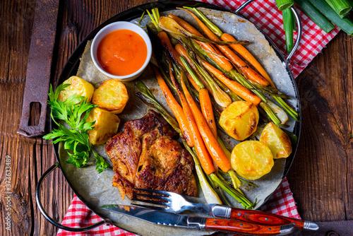 Fototapeta grilled neck chops with caramelized vegetables. obraz