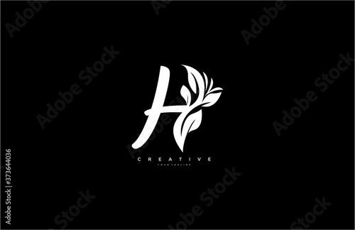 Tela Capital Letter H Monogram Flourishes Logotype