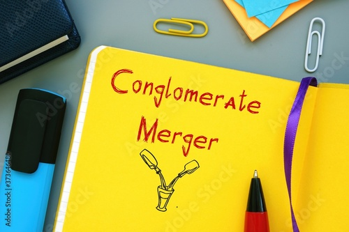 Fototapeta Business concept meaning Conglomerate Merger with phrase on the piece of paper