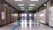 canvas print picture - School corridor with exit door. 3d illustration