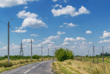 High Voltage Poles Stand Along The Road