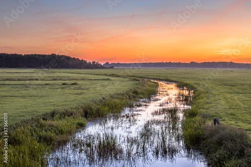 Sunset Landscape of lowland river Fototapet