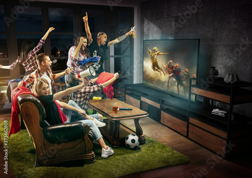 Fotografie, Obraz Group of friends watching TV, football match, sport together