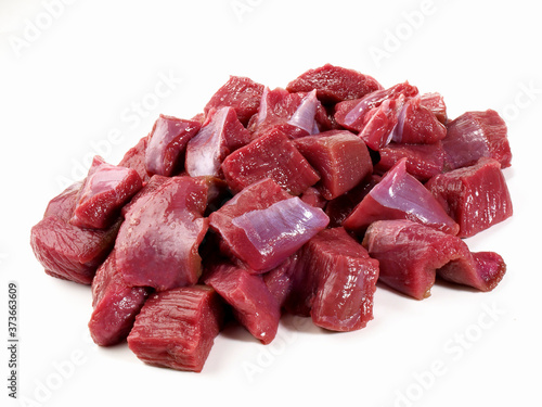 Vászonkép Raw Roe Deer Ragout - Wild Game Meat on white Background - Isolated