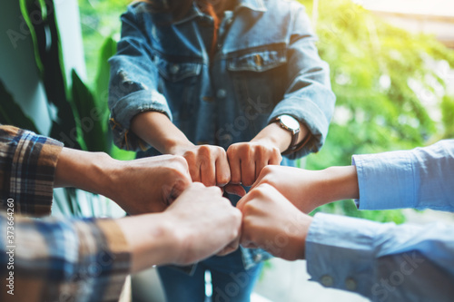 Fotografiet Group of business team work join their hands together with power and successful