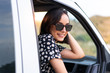 canvas print picture Young caucasian woman in a van at outdoors