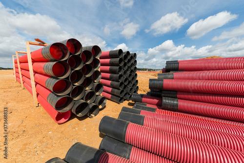 Fototapeta Entreposage de conduits et tuyaux en plastique sur chantier