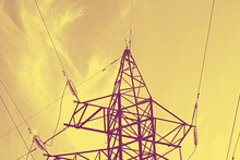 High-voltage Power Lines Tinted In Gold, High Voltage Power Transmission Tower.